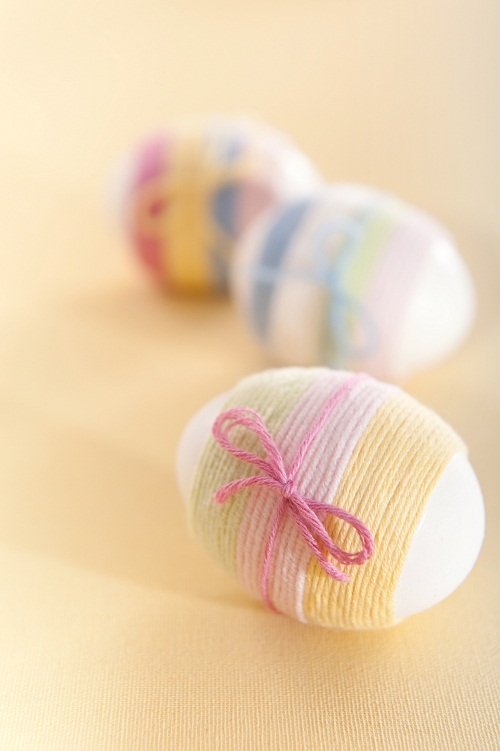 Striped yarn wrapped Easter eggs